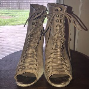 Aldo heeled lace up booties.